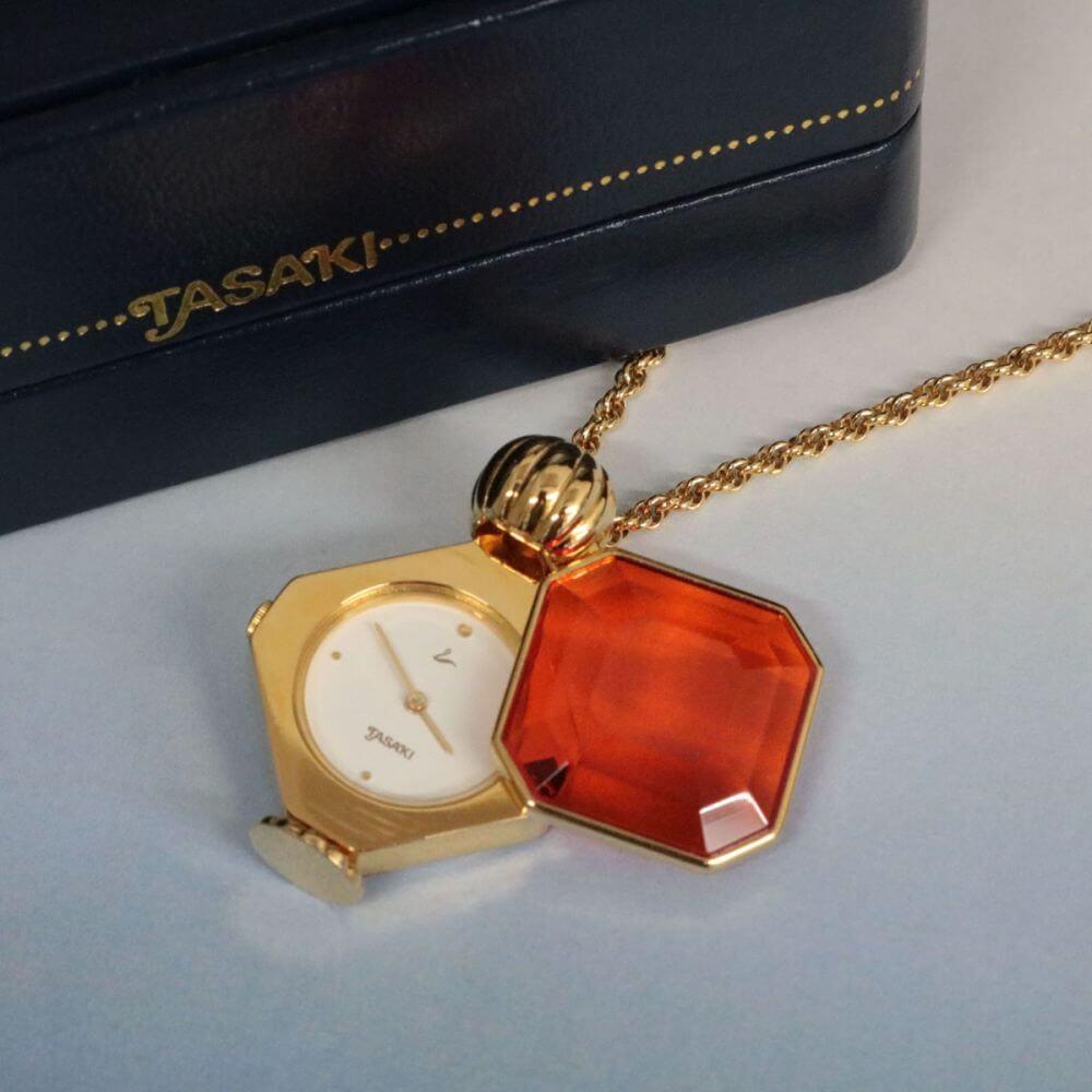 時計ネックレスタイプ/ゴールド×オレンジ